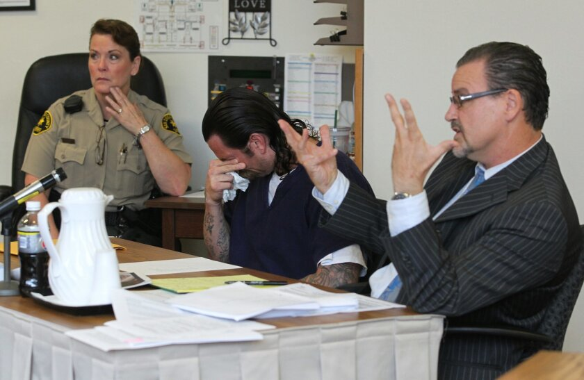 Richard Dale Fox, center, sobbed as his attorney, Tom Slattery, left, questioned a witness in the case.
