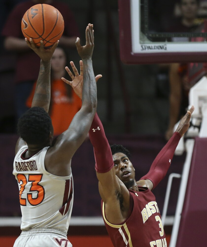 Virginia Tech's Tyrece Radford (23) shoots over Boston College's Jared Hamilton (3) during the first half of an NCAA college basketball game, Saturday, Feb. 8 2020, in Blacksburg Va. (Matt Gentry/The Roanoke Times via AP)