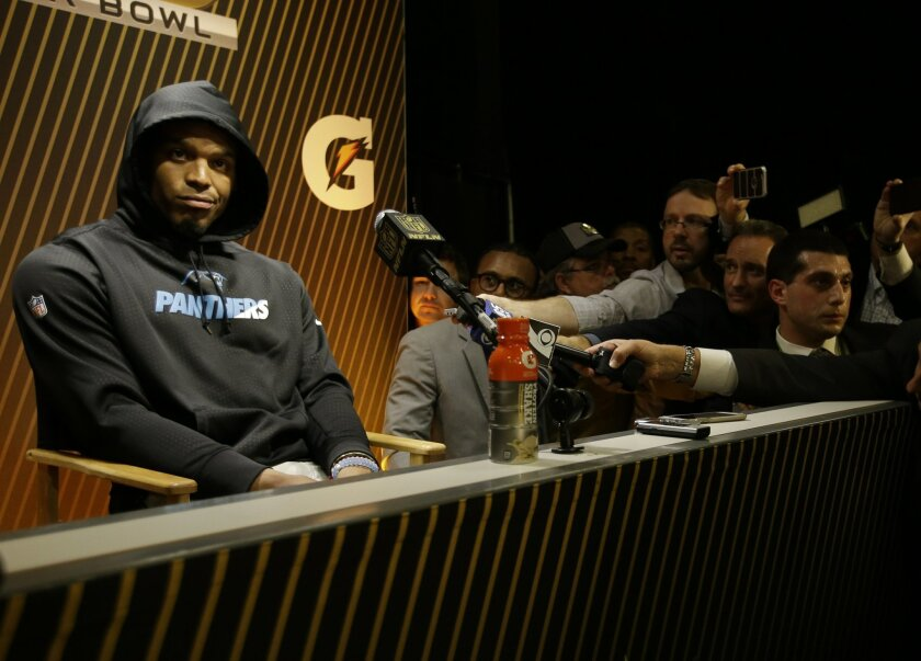 FILE - In this Feb. 7, 2016, file photo, Carolina Panthers' Cam Newton is shown during a press conference after Carolina's Super Bowl loss to Denver in Santa Clara, Calif. Panthers coach Ron Rivera gave an impassioned explanation Wednesday, March 23, 2016, of Cam Newton's heavily criticized behavior immediately after Carolina's Super Bowl loss to Denver. (AP Photo/Marcio Jose Sanchez, File)