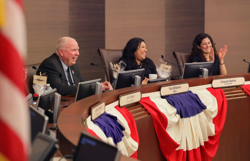 New Escondido Mayor Paul McNamara with new Councilmember Consuelo Martinez, middle, and Councilmember Olga Diaz, at right, acknowledge audience applause after Paul spoke at tonight's City Council meeting after Paul and Consuelo were sworn into office.