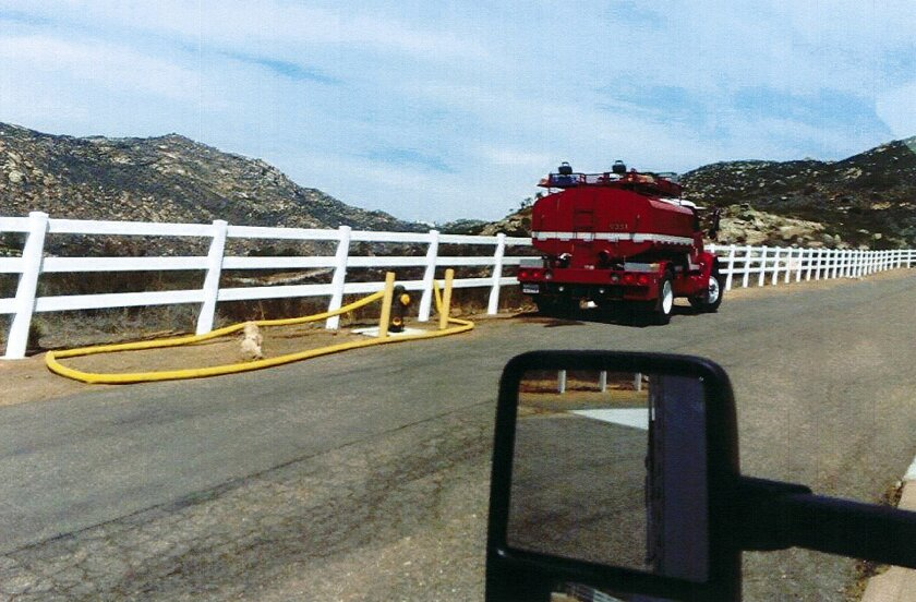 Photo taken by a Poway employee showing a San Pasqual Fire Department water tender filling up from a fire hydrant along Valleyview Road in Poway. The department was issued a $1,000 fine for water taken without payment. Source: City of Poway
