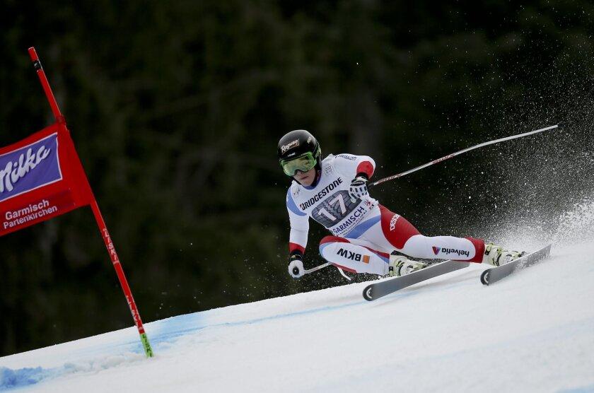 Switzerland's Lara Gut speeds down the course during an Alpine Ski women's World Cup Super G race, in Garmisch Partenkirchen, Germany, Sunday, Feb. 7, 2016. (AP Photo/Marco Trovati)