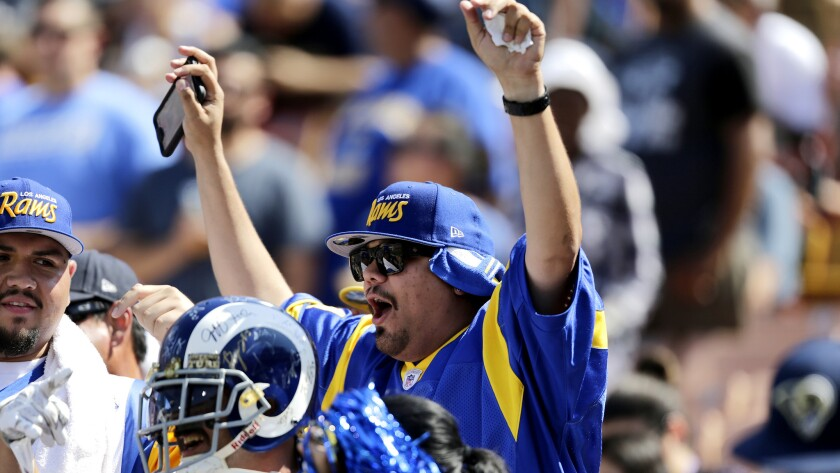 Rams fans cheer as the team takes the Coliseum field for its scrimmage on Aug. 6. (Gina Ferazzi / Los Angeles Times)