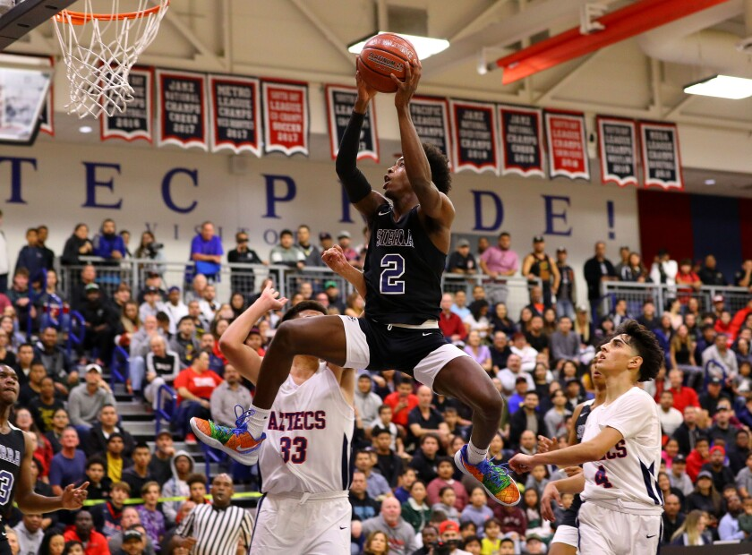 Zaire Wade goes airborne for Sierra Canyon in his debut on Thursday night in San Diego.