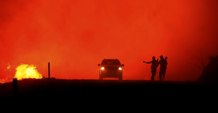 Photographers document the Kincade fire in the Geysers run as the fire approaches Geysers Road last month in Sonoma County.