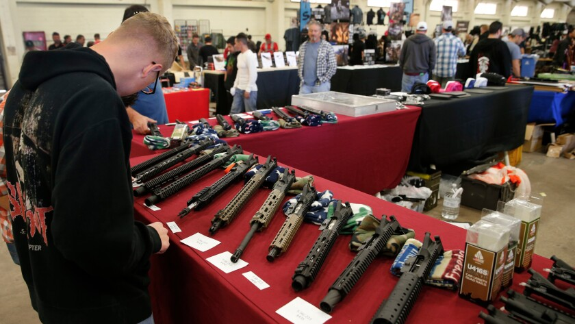 AR-15 semi-automatic assault rifle upper receiver parts and kits at the Crossroads of The West Gun Show in Del Mar, Calif., on Dec. 12, 2015.