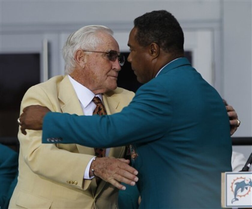 Former Miami Dolphins player Nat Moore, right, hugs former coach Don Shula during a ceremony honoring Shula prior to the the NFL football Pro Bowl Sunday, Jan. 31, 2010, in Miami. (AP Photo/J. Pat Carter)