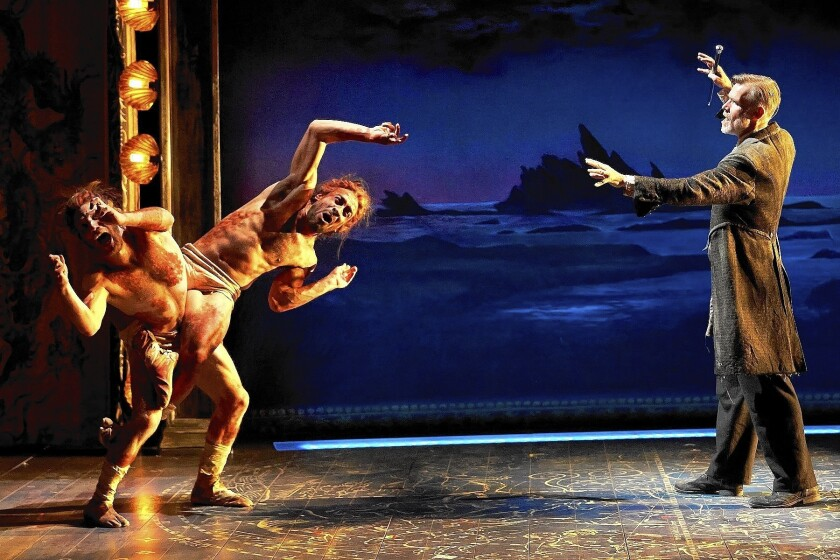 """Caliban (Zach Eisenstat and Manelich Minniefee) is dealt with by Prospero (Tom Nelis) in """"The Tempest."""""""