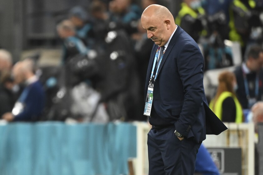 Russia's manager Stanislav Cherchesov is dejected after the Euro 2020 soccer championship group B match between Russia and Denmark at the Parken stadium in Copenhagen, Denmark, Monday, June 21, 2021. Denmark won 4-1. (Jonathan Nackstrand/Pool via AP)