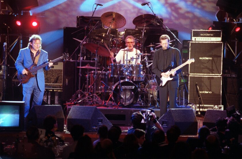 In this 1993 file photo, members of the rock group Cream perform in Los Angeles during the 8th Annual Rock and Roll Hall of Fame induction ceremony in Los Angeles. Shown from left are Jack Bruce, Ginger Baker and Eric Clapton.