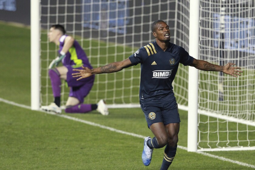 Philadelphia Union's Cory Burke, right, celebrates his goal against the Chicago Fire during the second half of an MLS soccer match Wednesday, Oct. 28, 2020, in Chester, Pa. (Charles Fox/The Philadelphia Inquirer via AP)