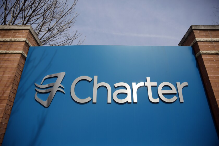 Signage at an entrance to Charter Communications' headquarters in Town and Country, Mo.