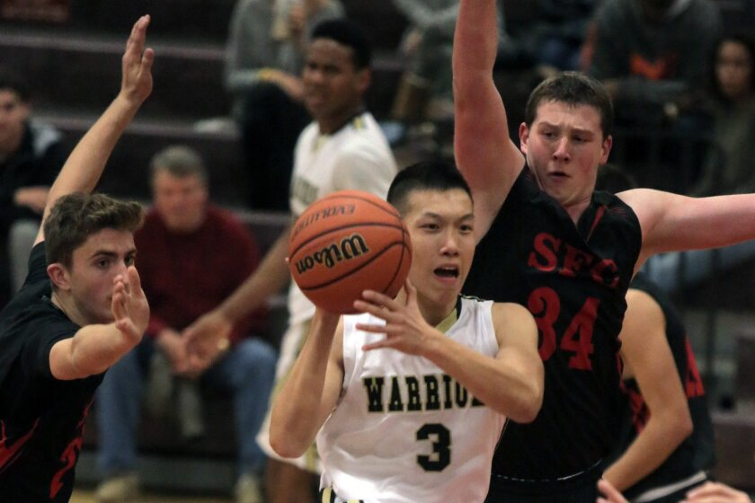 Army-Navy's Weijie Zhang looks to pass against Santa Fe Christian's Matthew Stevenson (left) and Charles Dudley (right) as the Warriors recorded a 61-43 win Tuesday in the Senators Division third-place game of the Holiday Classic at SFC. No local teams won division titles in this year's 25th annual