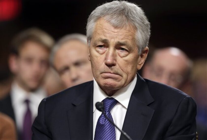 FILE - In this Jan. 31, 2013, file photo, Republican Chuck Hagel, President Obama's choice for Defense Secretary, testifies before the Senate Armed Services Committee during his confirmation hearing on Capitol Hill in Washington. Senate Republicans on Feb. 14, 2013, temporarily blocked a full Senat