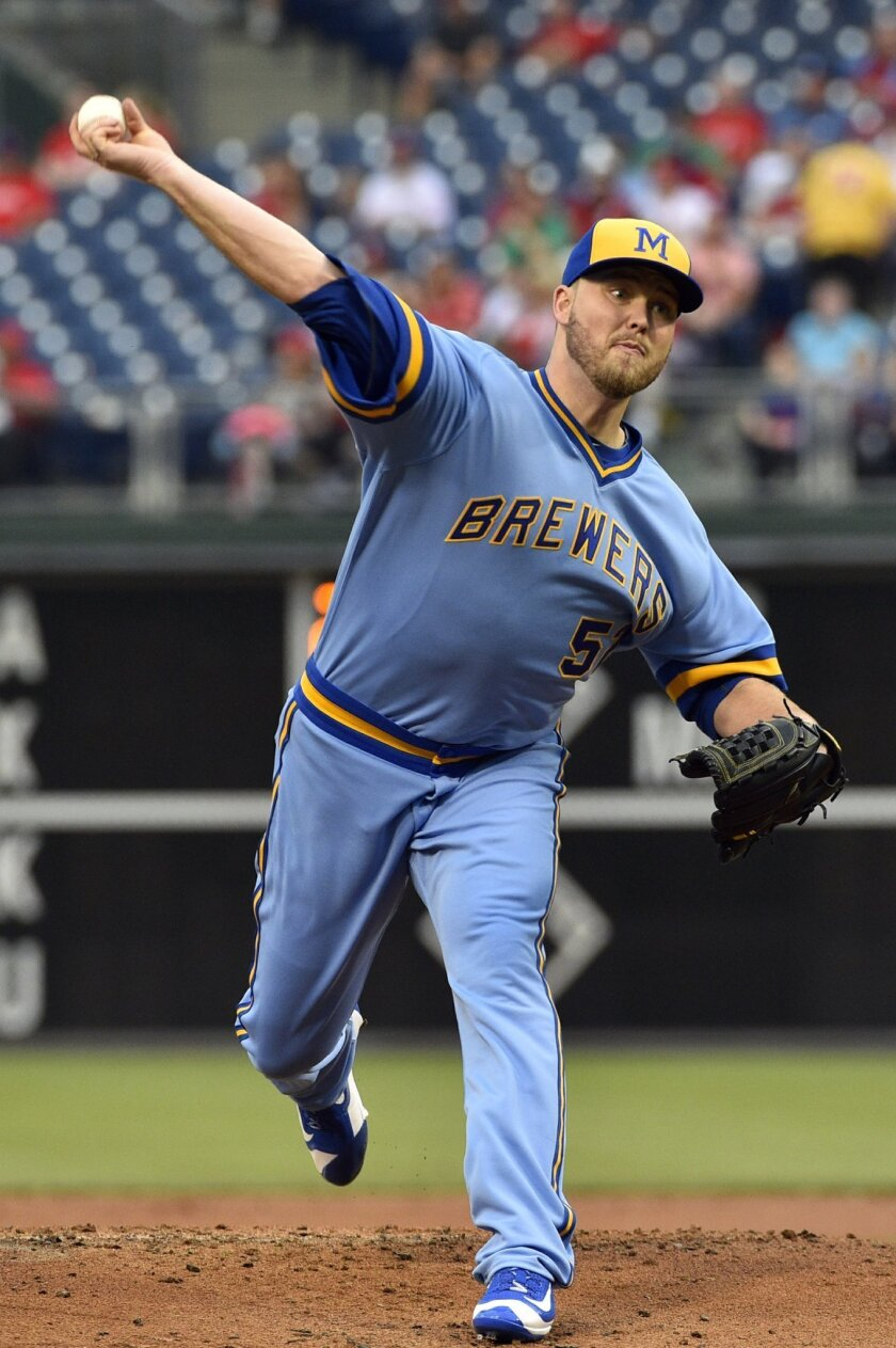 Milwaukee Brewers starting pitcher Jimmy Nelson throws during the first inning of a baseball game against the Philadelphia Phillies, Friday, June 3, 2016, in Philadelphia. (AP Photo/Derik Hamilton)