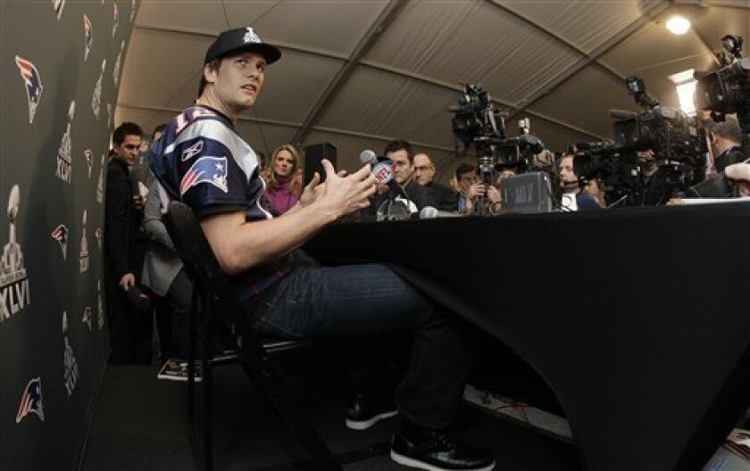 New England Patriots quarterback Tom Brady answers questions during a news conference on Thursday, Feb. 2, 2012, in Indianapolis. The Patriots are scheduled to face the New York Giants in NFL football Super Bowl XLVI on Feb. 5. (AP Photo/Mark Humphrey)