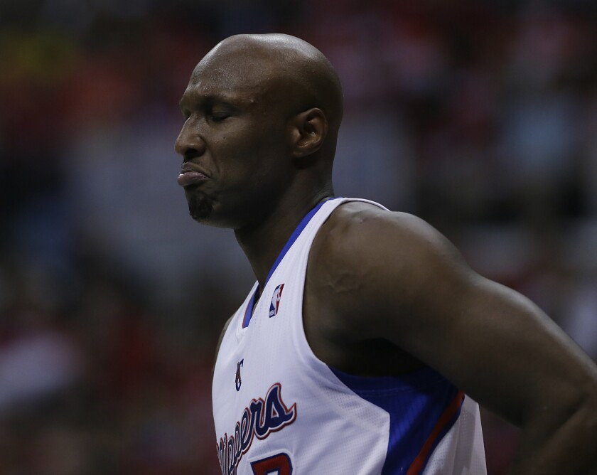 Lamar Odom plays in a Clippers basketball game last spring at Staples Center.