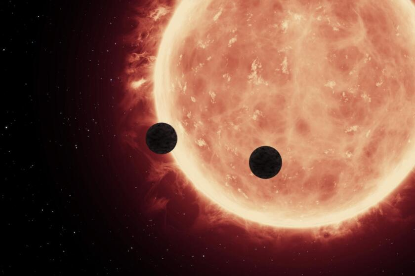 An artist's depiction shows two planets transiting an ultra-cool dwarf star, TRAPPIST-1. NASA's Hubble Space Telescope has characterized two planets' atmospheres.
