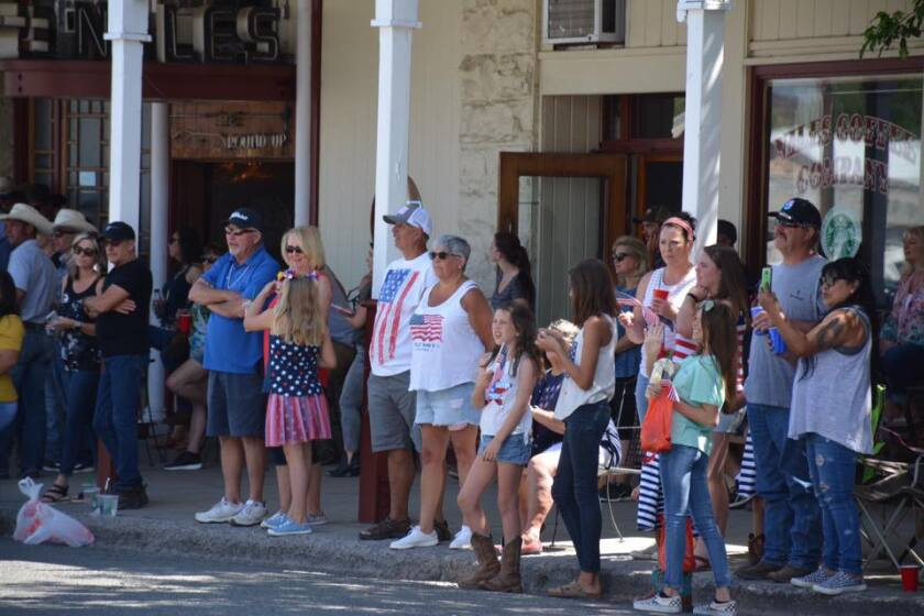 Modoc County residents watch a Fourth of July parade. Most don't wear face masks despite the threat of the coronavirus.