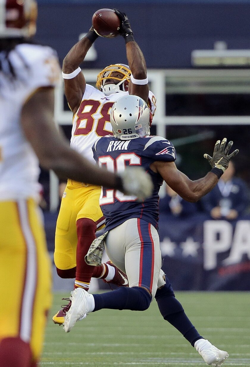 Washington Redskins wide receiver Pierre Garcon (88) catches a pass over New England Patriots cornerback Logan Ryan (26) during the second half of an NFL football game, Sunday, Nov. 8, 2015, in Foxborough, Mass. (AP Photo/Steven Senne)