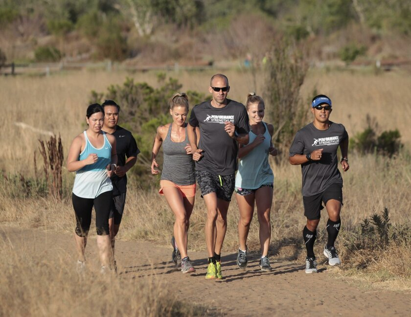 Performance Strength Lab runners hit the trail at Mission Trails Regional Park in Santee. Good form is essential for long-distance runs, and that includes a warmup, with dynamic stretches. Poor form is a major cause of ailments such as shinsplints, knee and iliotibial injuries, and plantar fasciiti