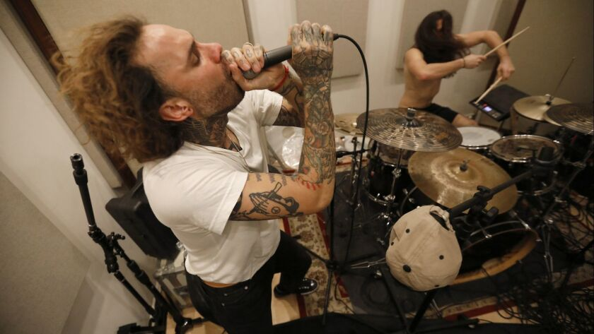 Fever 333 vocalist Jason Aalon Butler and drummer Aric Improta rehearse in Van Nuys.