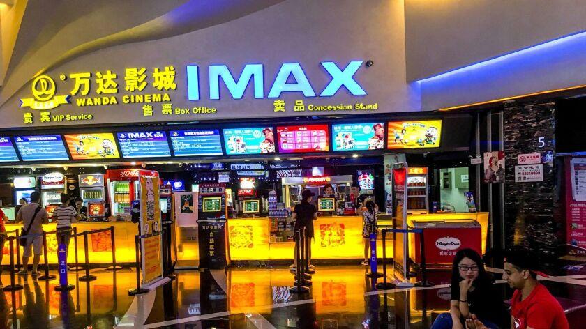 Customers buy film ticket in a Wanda IMAX cinema. Wanda