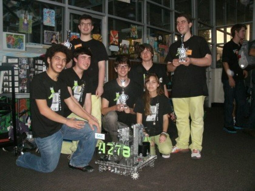 De-Evolution team members with their robot and trophies awarded for winning their second tournament this season: Yousuf Soliman, Ryan Lee, Colin Murphy, Nic Stone, Noah Sutton-Smolin, Merry Hodgman, Tristan Murphy