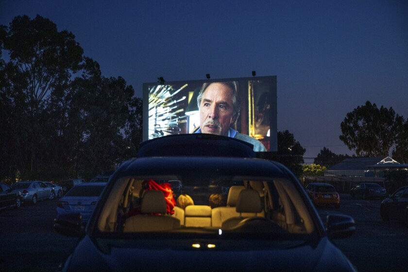 "The Mission Tiki Drive-In Theatre in Montclair during a socially distant showing of ""Knives Out,"" with Don Johnson on the screen."