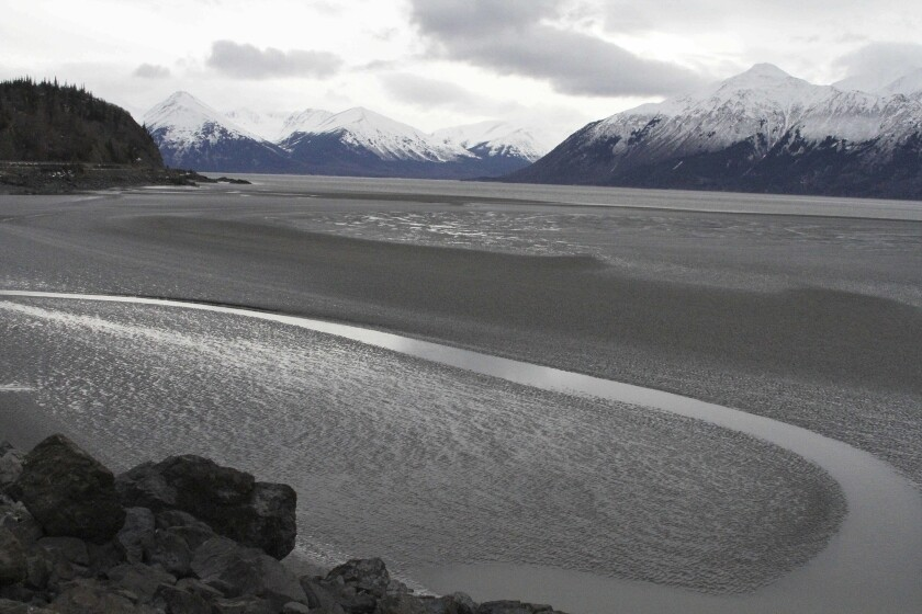 A ribbon of water cuts through the mud flats of Cook Inlet, just off the shore of Anchorage, Alaska, onMarch 7, 2016.