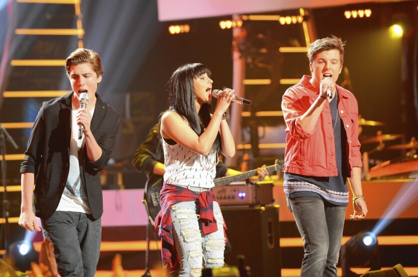 "Sam Woolf, left, Jena Irene and Alex Preston perform on ""American Idol"" last month, in the show's 13th season."