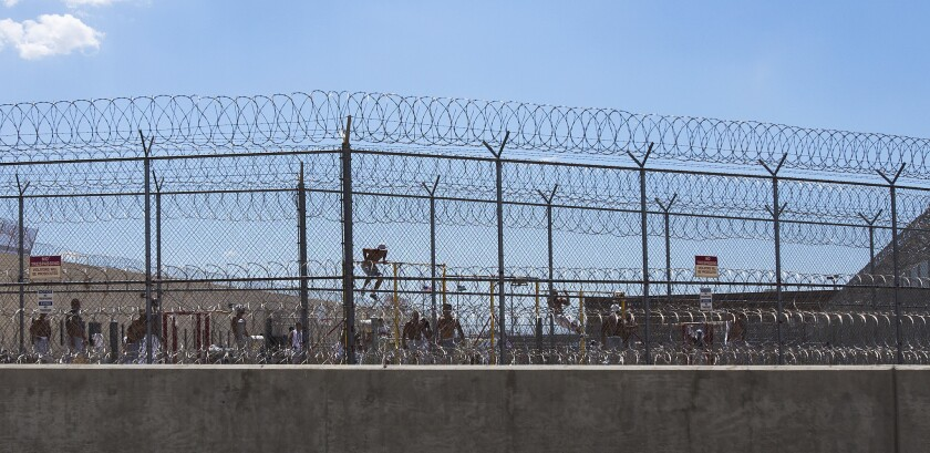 Immigrants being held at the Adelanto Detention Facility, seen in 2014, have ended a hunger strike, officials said Monday.