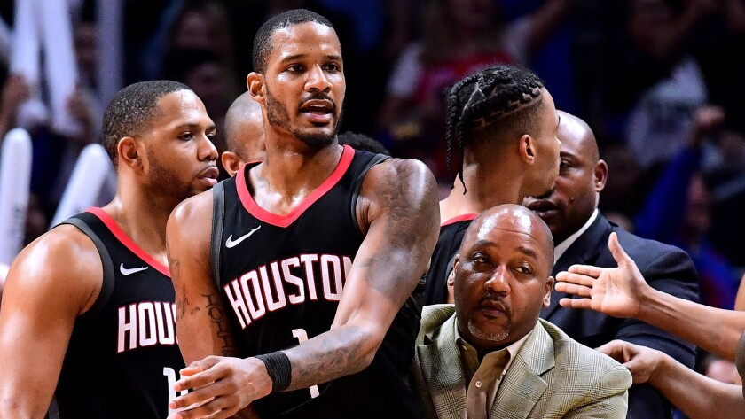 Rockets forward Trevor Ariza is restrained during an on-court scuffle against the Clippers on Monday night. He was eventually ejected from the game.