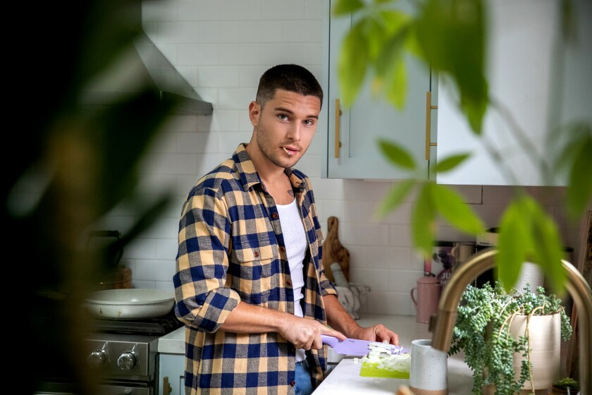 Actor Ronen Rubinstein finds that chopping onions with a matchstick in his mouth keeps his eyes from tearing. He's on a vegan kick.
