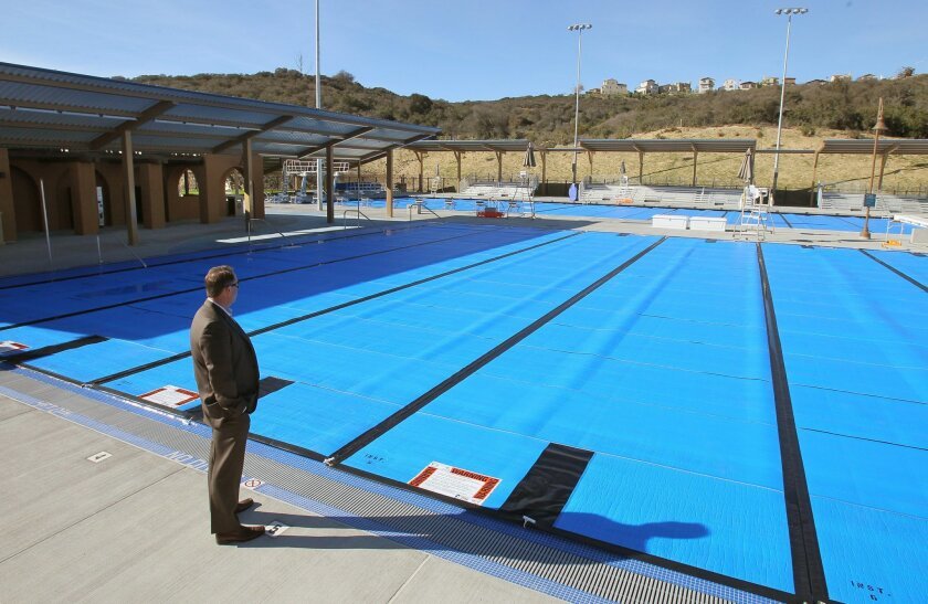 View of the new swimming pool complex at Alga Norte Community Park. In the foreground is Chris Hazeltine, the director of the Carlsbad Parks & Recreation Department.
