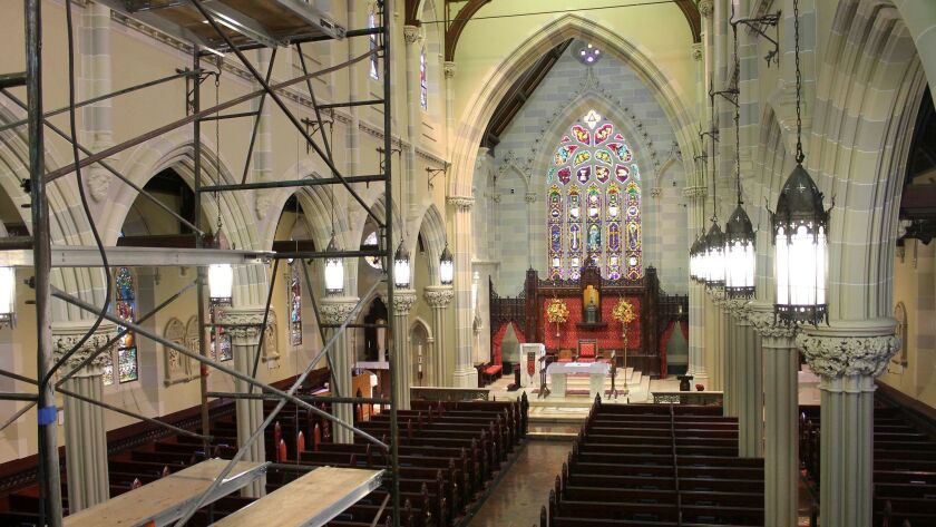 In this 2016 photo, scaffolding is used to help disassemble the organ stands in the sanctuary of St. Mary's Church in Newport, R.I. The church where John F. Kennedy and Jacqueline Bouvier married in 1953 is inviting the public to visit and learn about the wedding.