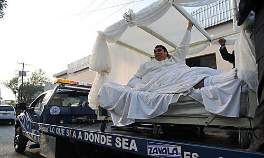 """Manuel """"Meme"""" Uribe, 43, is driven in a forklift to the dance hall where he and Claudia Solis will get married in Monterrey, Mexico, Sunday, Oct. 26, 2008. Uribe, who tipped the scales in 2006 at 1,230 pounds, earning him the Guinness Book of World Records' title for the world's heaviest man, lost 550 pounds (250 kilograms) with the help of Solis, whom he met four years ago."""