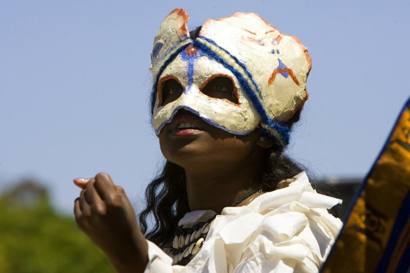"""Loren Lott, a student at the Common Ground Youth Academy, takes a turn in a """"Macbeth"""" presentation."""