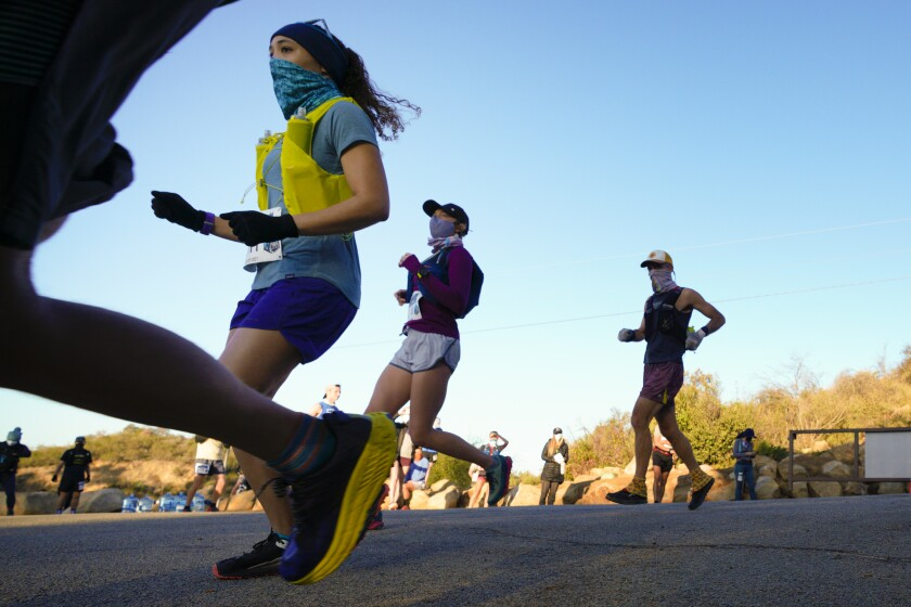 At Daley Ranch in Escondido on Saturday, runners mask up for a 50K and half marathon
