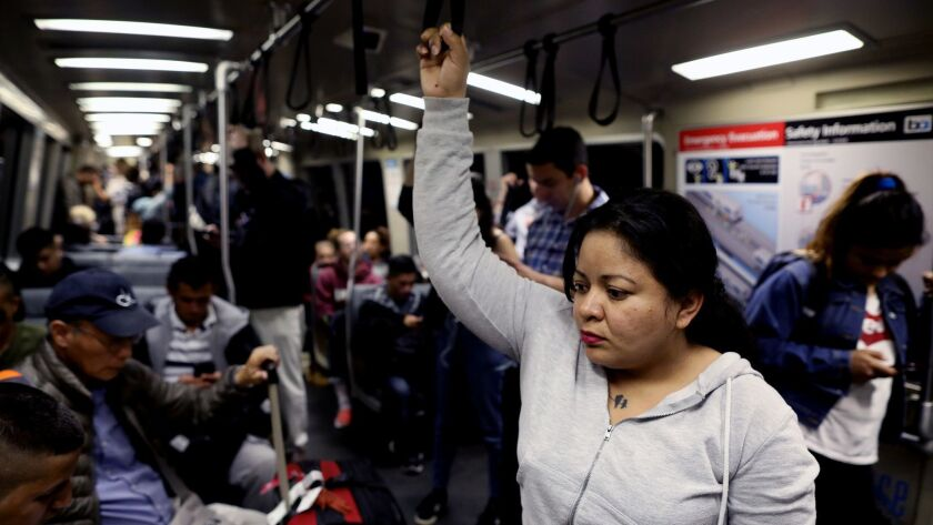 Veronica Aguilar, of El Salvador, fled her home country after receiving death threats from local gangs. Aguilar now lives with sponsor family Kent and Ann Moriarty in Pinole, Calif. Above she rides a BART train in Berkeley.