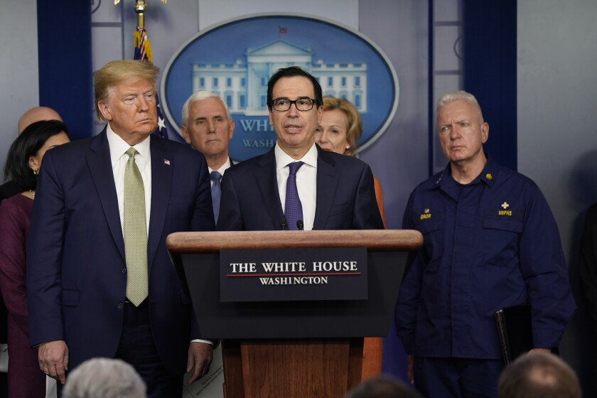 Treasury Secretary Steven Mnuchin, center, speaks during a news briefing with the coronavirus task force at the White House on Tuesday.