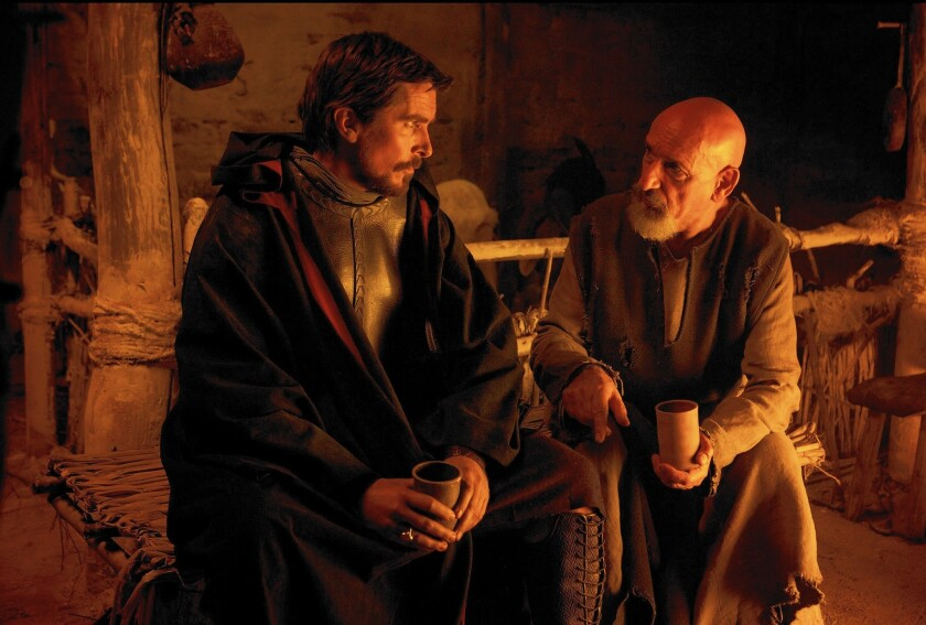 """Moses (Christian Bale) confers with Nun the Scholar (Ben Kingsley) in """"Exodus: Gods and Kings."""""""