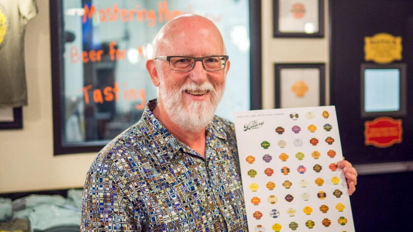 Randy Mosher signs posters of all The Bruery labels that he's designed in Orange County on June 16.