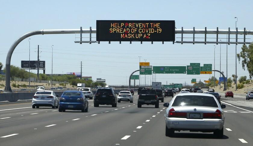 Arizona highway sign urging mask-wearing