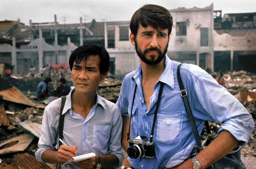 "Sam Waterston, right, as Sydney Schanberg and Haing S. Ngor as Dith Pran in ""The Killing Fields."""