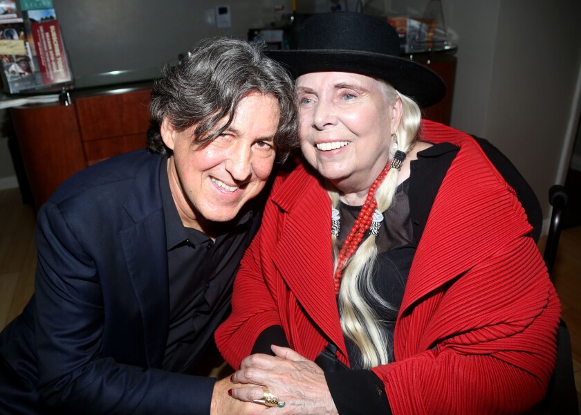"Music legend Joni Mitchell (right) and San Diego-bred film director and writer Cameron Crowe (left) are shown here at San Diego's Old Globe theater following the Sept. 27 world premiere of the musical version of ""Almost Famous."" Mitchell, 76, will receive the Les Paul Innovation Award at the NAMM Show's annual TEC Awards in January in Anaheim."