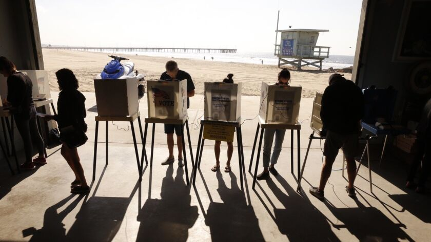 Voters line up to casts their ballots near the Venice Pier in Venice, Calif. on Nov. 6, 2018.