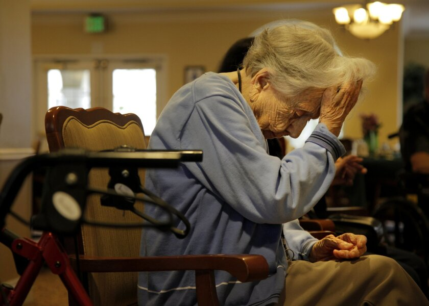 Alice Frazier, 103, rests between exercises in the lobby of Emeritus Carlsbad Wednesday. For many of the seniors living at the Emeritus Carlsbad facility, exercise and other activities like puzzles and bingo are part of their daily activity options.