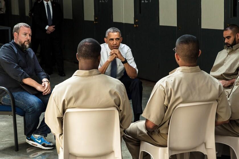 President Obama listens to prisoners.