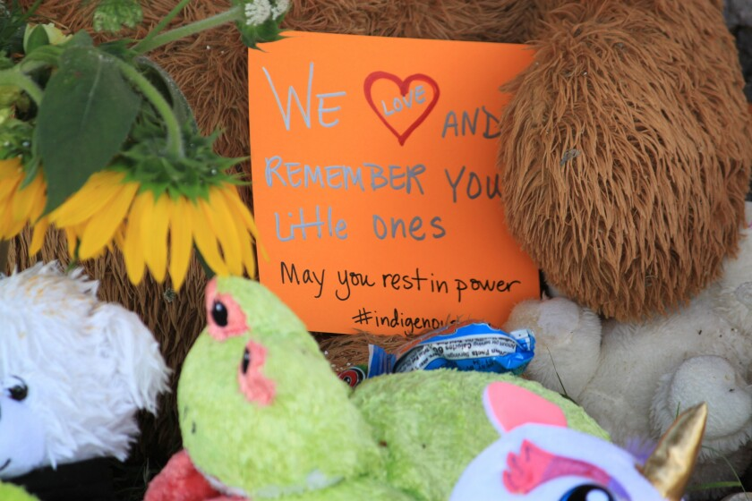 A makeshift memorial for the dozens of Indigenous children who died more than a century ago while attending a boarding school that was once located nearby is growing under a tree at a public park in Albuquerque, N.M., Thursday, July 1, 2021. Indigenous activists are concerned that a plaque that noted the site of the burial ground was removed in recent days. (AP Photo/Susan Montoya Bryan)